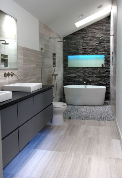 gray-striped-tile-floor-gray-vanity-with-drawers-black-counter-top-white-ceramic-sinks-wall-mount-faucets-frameless-glass-enclosure-tub-inside-of-shower