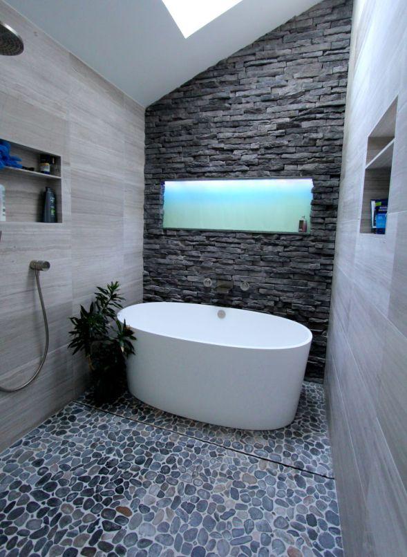Victoria-and-Albert-bathtub-with-back-lit-glass-shelf-above-tub-and-splish-splash-hidden-drain-system