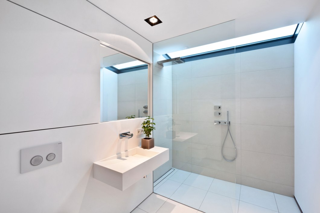 housing-building-of-seven-units-in-kirchberg-keribrownhomes-minimalist-bathroom-design-for-small-spaces-with-glass-room-divider-white-interior-color-decorating-ideas-ceramic_tile-sh